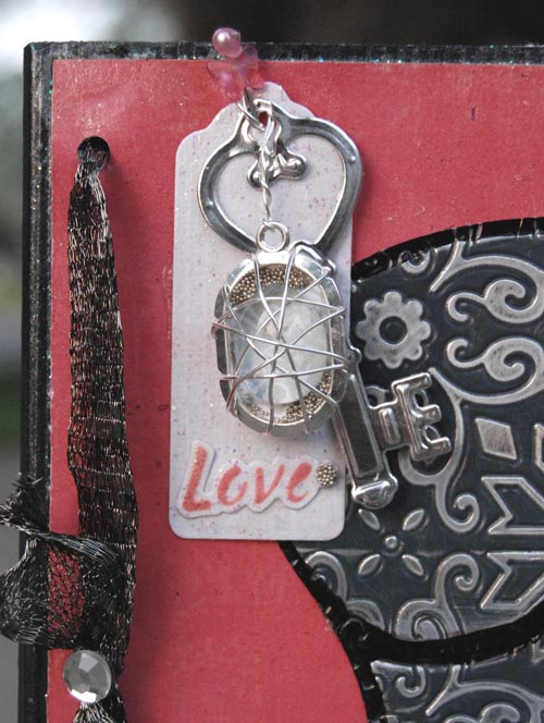 Holly Love Tag and Pendant closeup
